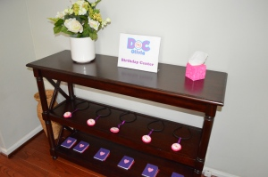 Doc McStuffins Birthday Party Registration Desk with handmade stethoscopes and book of boo-boos